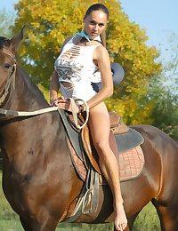Naked stunning busty Alena riding horse