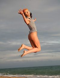 Very skinny and natty teen jumping and flying naked on the shore